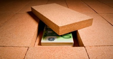 money-hidden-under-a-brick